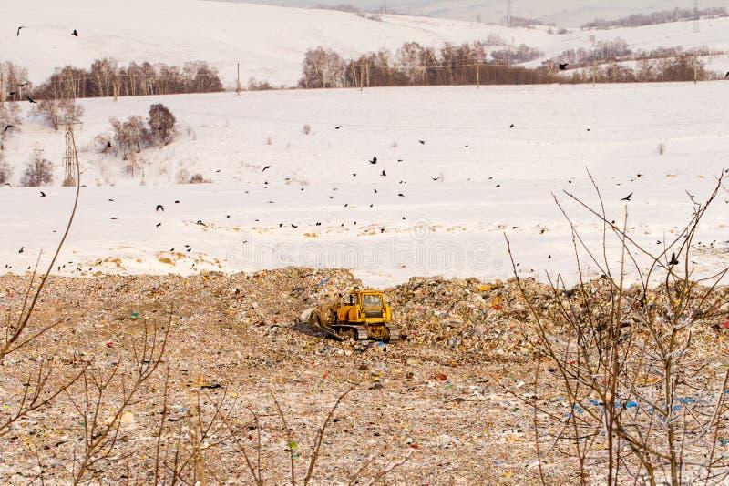 Lo scarico ed il bulldozer immagini stock