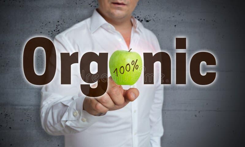 Lo schermo attivabile al tatto organico è azionato dall'uomo immagine stock