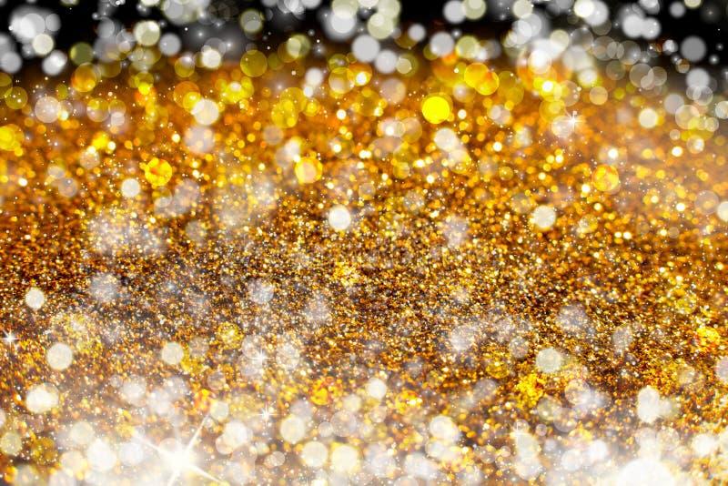 Lo scintillio accende l'oro o il fondo giallo di lerciume Fondo Twinkly astratto defocused di Natale delle luci e delle stelle di fotografie stock libere da diritti
