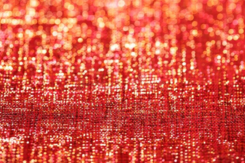 Lo scintillio rosso dorato scintilla priorità bassa fotografia stock libera da diritti