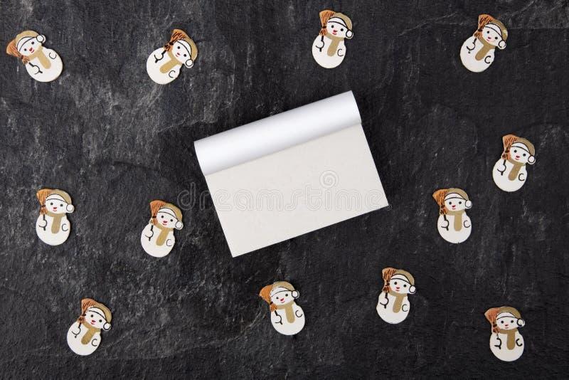 Lo spazio in bianco regista con Toy Snowman immagini stock libere da diritti