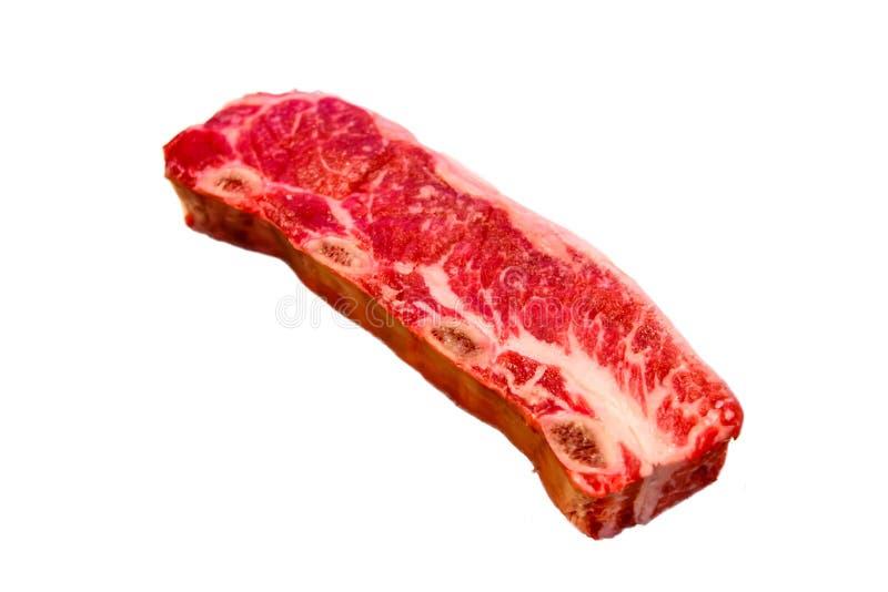 Lo stile della bistecca di manzo Kalbi/Flanken Ribs le bugie su un fondo bianco fotografia stock libera da diritti