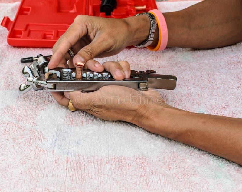 Lo strumento di dimostrazione utilizzato per il chiarore di rame del tubo fotografia stock libera da diritti