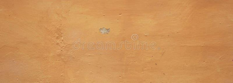 Lo stucco ha dipinto il fondo di struttura della parete, giallo, colore, insegna immagine stock libera da diritti