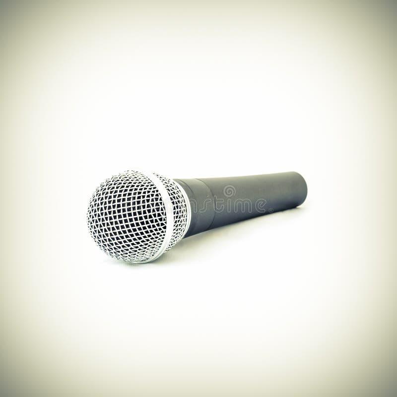 Lo studio filtrato del tono ha sparato il microfono senza fili di vista superiore isolato fotografia stock libera da diritti
