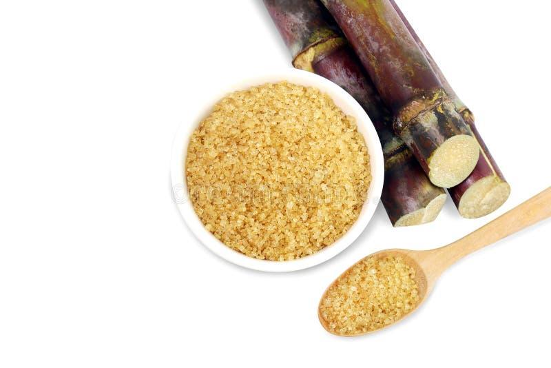 Lo zucchero della canna da zucchero, zucchera il marrone in una tazza bianca, il pezzo fresco della canna da zucchero, giallo del fotografie stock libere da diritti