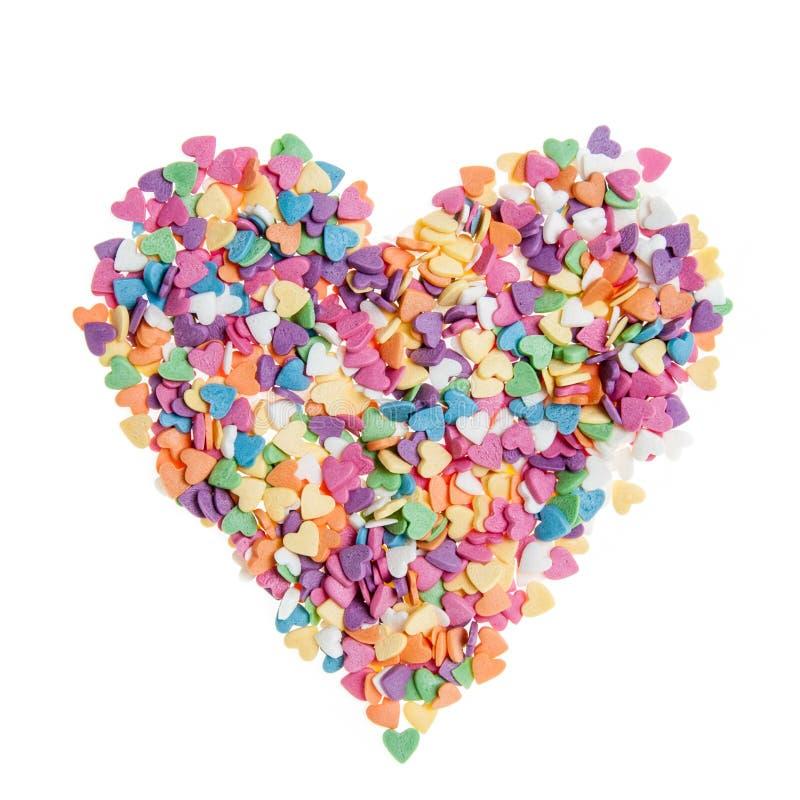 Lo zucchero spruzza i cuori dei punti, decorazione per il dolce e forno, come fondo immagini stock libere da diritti