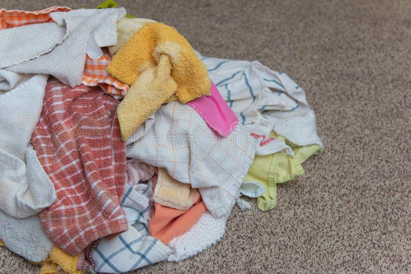 Load of Clean Hand Towels Ready to Be Folded on the Floor. A Load of Clean Hand Towels Ready to Be Folded on the Floor royalty free stock photo