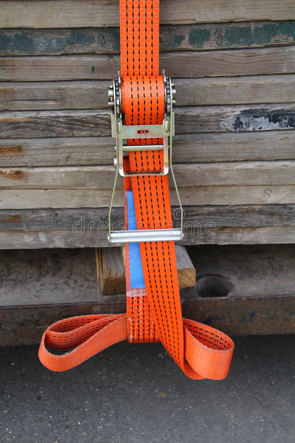 Load strap. New load strap used to firmly carry load of scaffolding planks royalty free stock photos