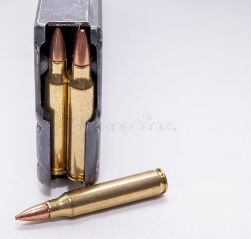 A loaded 223 caliber rifle magazine on a white background. With added room for text royalty free stock photography