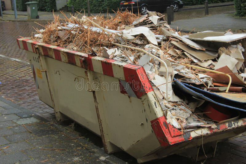 Loaded dumpster. Near a construction site, home renovation royalty free stock photos