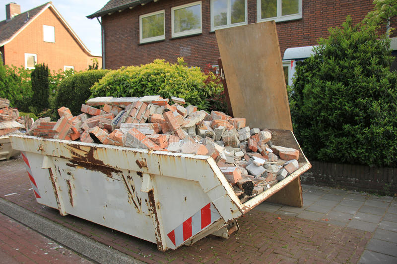 Loaded dumpster. Near a construction site, home renovation royalty free stock image