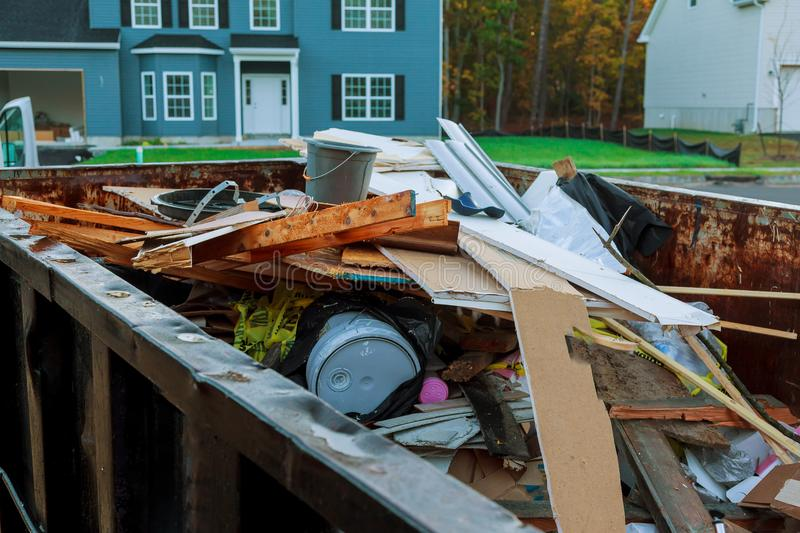 Roll-off dumpster filled with building rubble. Loaded dumpster near a construction site, home renovation dumpster filled with building rubble dumpster royalty free stock photo