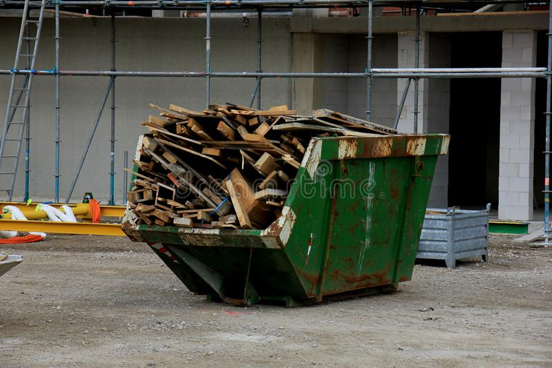 Loaded garbage dumpster. Loaded dumpster near a construction site, home renovation royalty free stock images