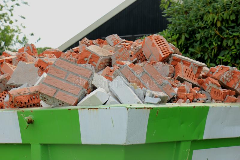 Loaded garbage dumpster. Loaded dumpster near a construction site, home renovation stock images