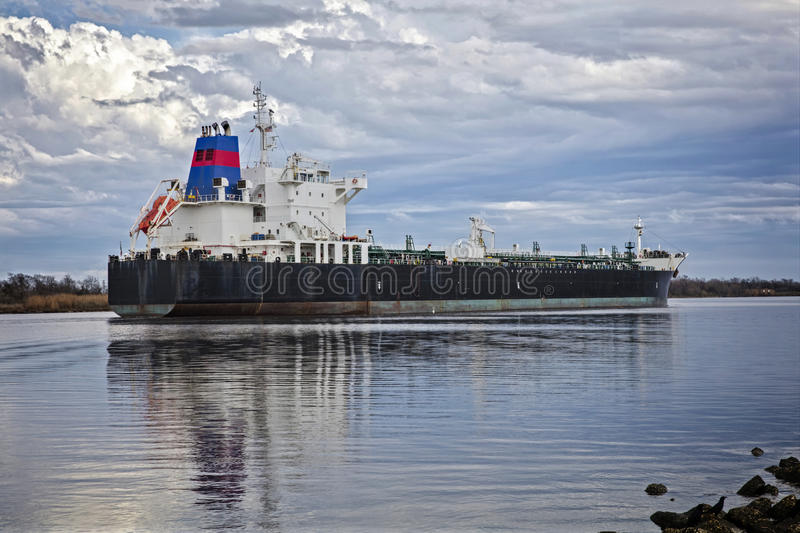 Loaded Oil Tanker Headed to Sea. Loaded Tanker Headed to Sea by river ship channel stock photo