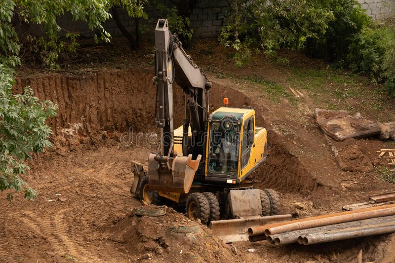 Loader backhoe,excavator digging a trench,Work of excavating machine on building construction site royalty free stock images
