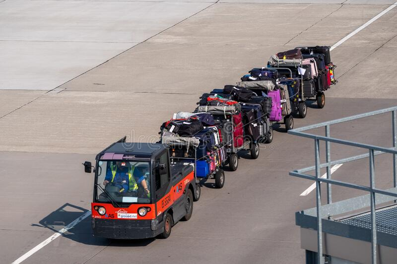 Loader carries passengers luggage at the airport royalty free stock images