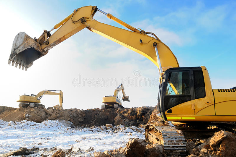 Loader excavator bulldozers at work royalty free stock photos