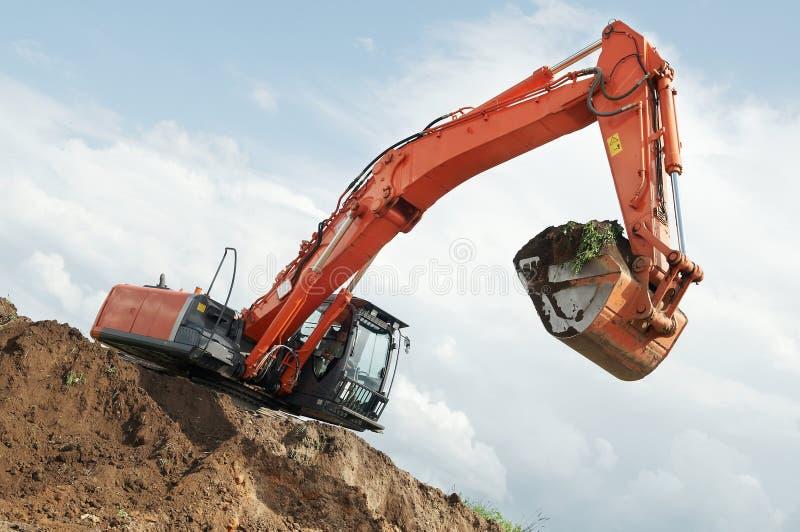 Loader excavator at construction royalty free stock photo