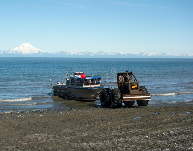 A boat being hauled out of the water with machinery as seen at low tide in alaska royalty free stock photos