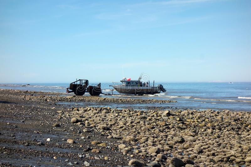A boat being hauled out of the water with machinery as seen at low tide in alaska royalty free stock photography