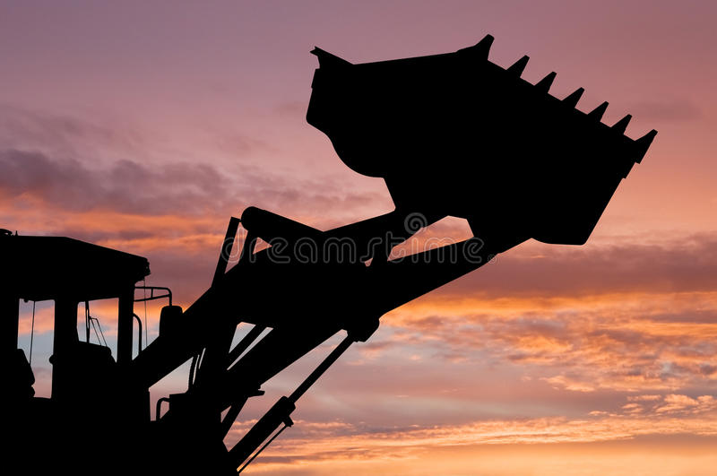 Loader shovel silhouette royalty free stock photography