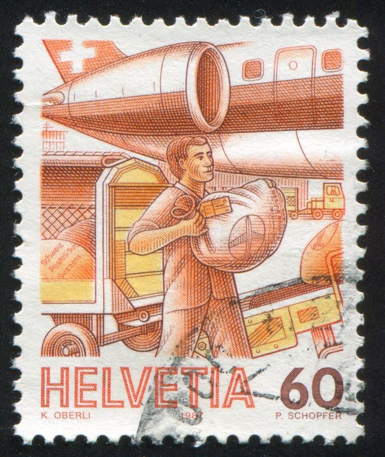 Loading Airmail. SWITZERLAND - CIRCA 1987: stamp printed by Switzerland, shows Loading Airmail, circa 1987 royalty free stock photos