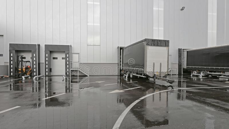 Loading Bay. Truck and Trailer at Distribution Warehouse Loading Dock royalty free stock photo