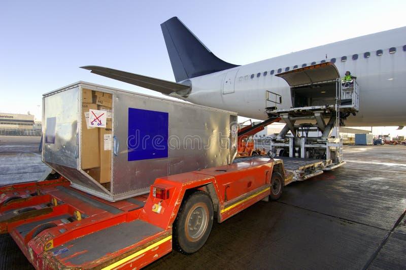 Loading cargo onto aircraft stock photos