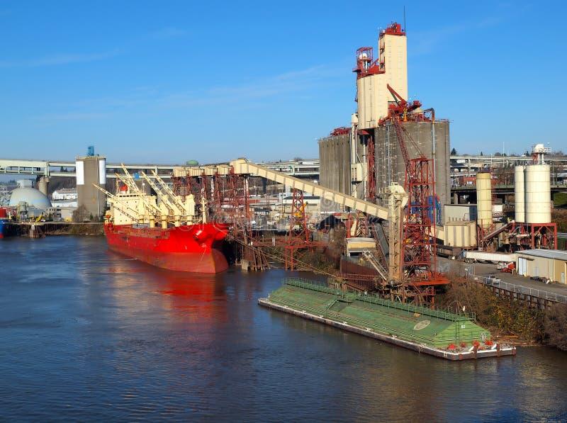 Loading a cargo ship, grain elevators Portland OR. stock images
