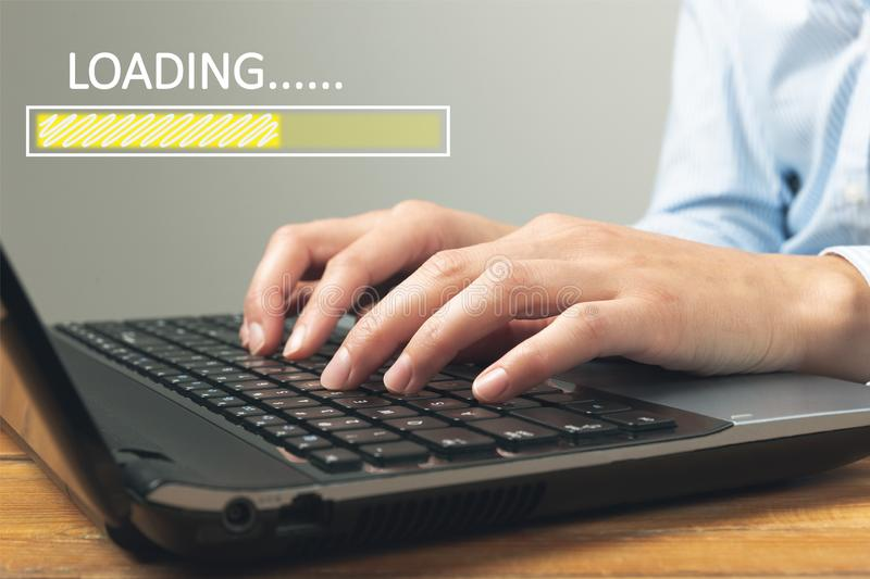 Loading concept with woman using a laptop in a home office. Freelance, online business, start up business stock photos