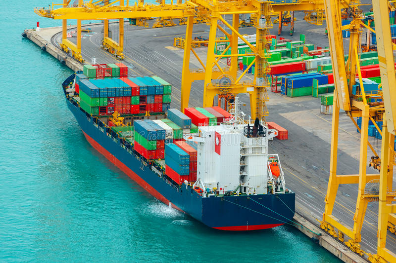 Loading containers on a sea cargo ship, Barcelona royalty free stock image