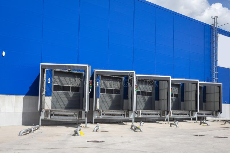 Loading dock at a warehouse. modern logistics center. docking stations of a distribution center. Loading dock at a warehouse. modern logistics center. docking stock photography