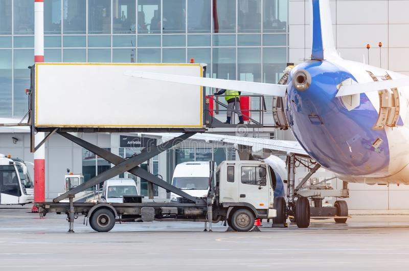 Loading food on the plane for passengers at the terminal royalty free stock photos