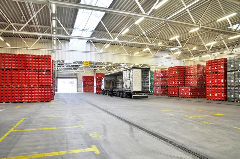 Loading of goods in a brewery warehouse - beer crates with beer stock images