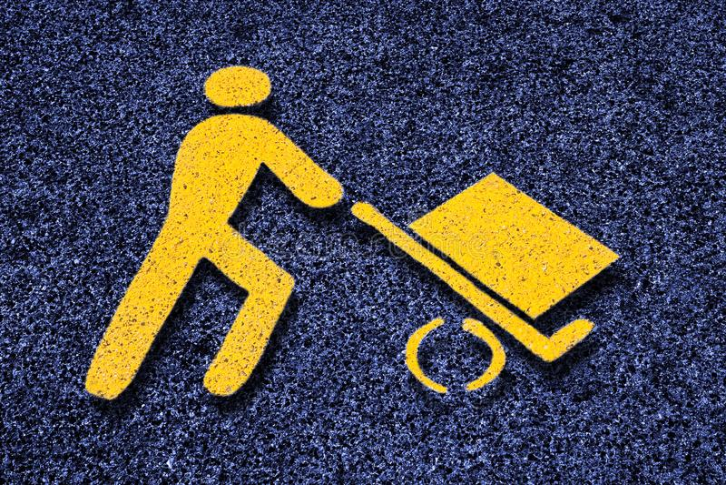 Loading goods urban symbol on asphalt road - toned image.  stock image