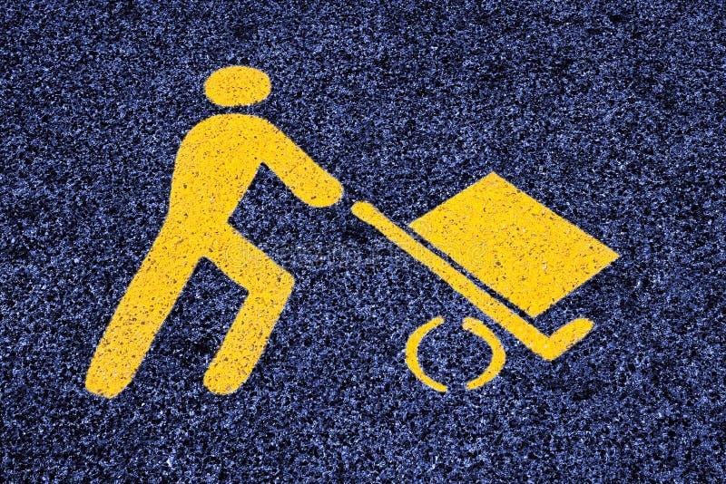 Loading goods urban symbol on asphalt road - toned image.  stock photos