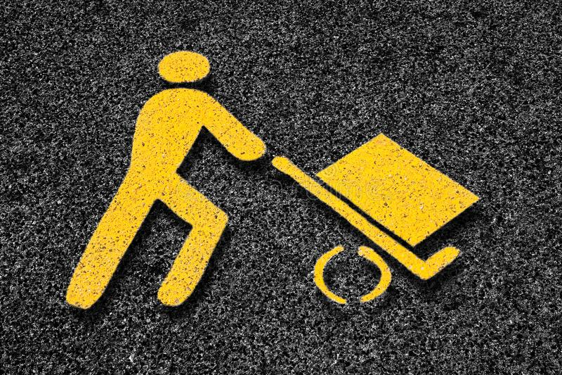 Loading goods urban symbol on asphalt road - toned image.  royalty free stock image