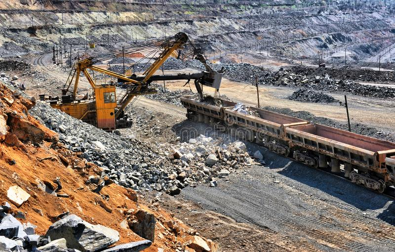 Loading of iron ore on the train royalty free stock photo