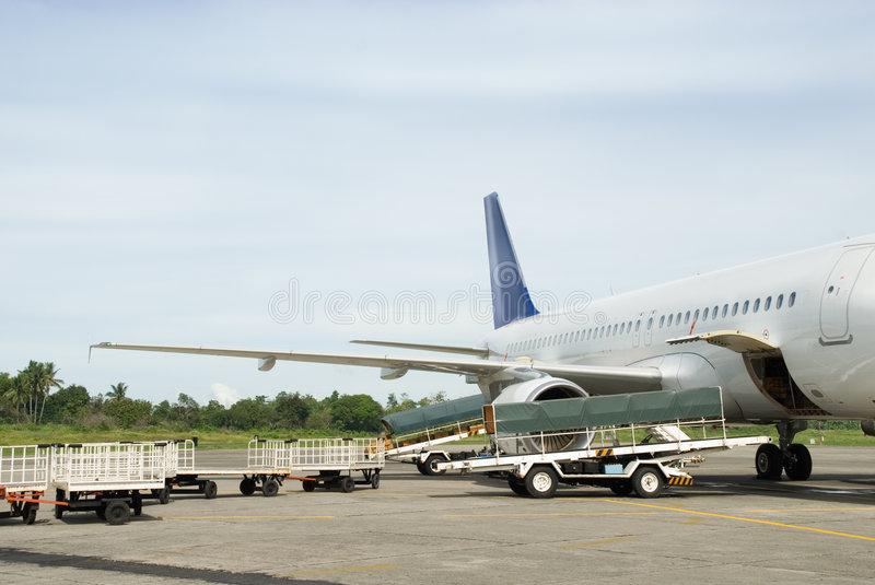 Download Loading Luggage In Airplane Stock Photo - Image: 7727036