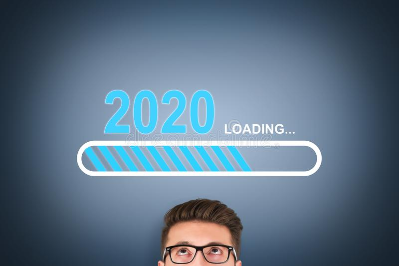 Loading New Year 2020 over Human Head on Visual Screen stock photography