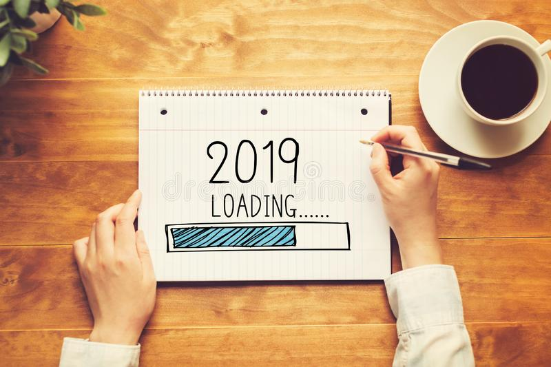 Loading new year 2019 with a person holding a pen royalty free stock photography