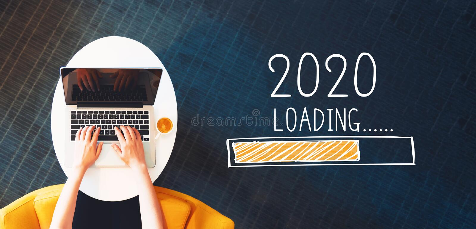 Loading new year 2020 with person using a laptop royalty free stock image