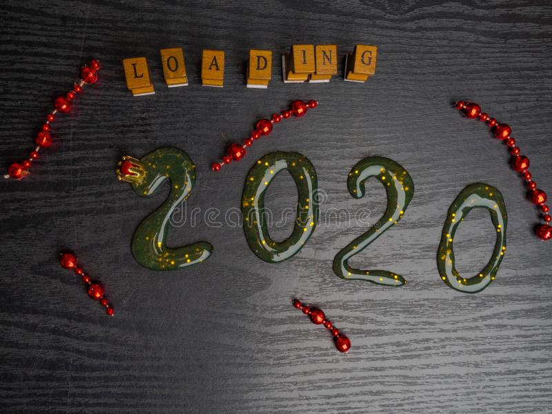 Loading for new 2020 year on wooden board, copy space royalty free stock photos