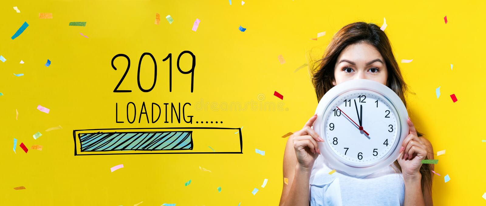 Loading new year 2019 with young woman holding a clock stock photography