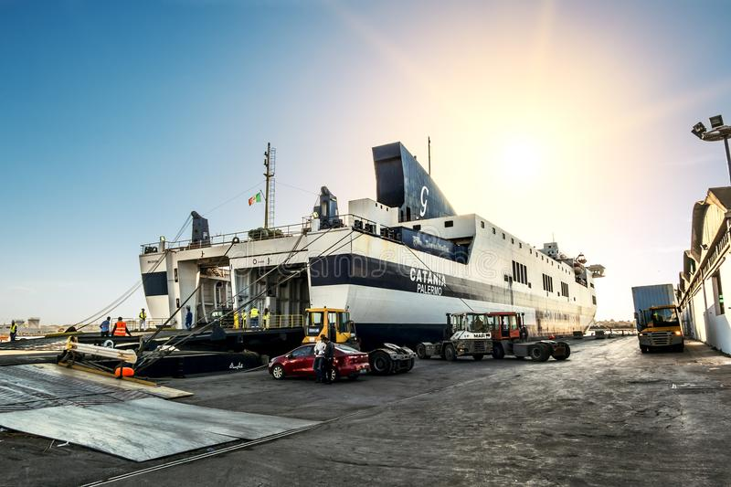 Loading onto the ferry Grimaldi Lines Catania to the port of La royalty free stock image