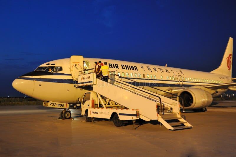 Loading the plane royalty free stock photo