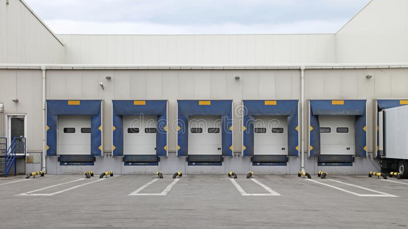 Cargo Doors. Loading Ramp Cargo Doors at Distribution Center Warehouse royalty free stock photos