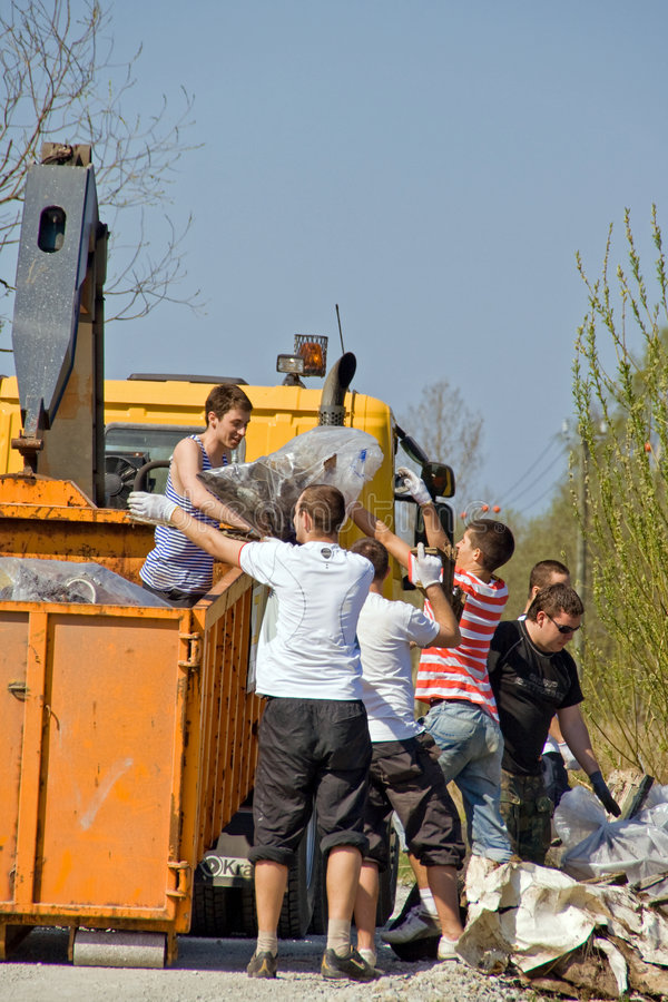 Loading trash on truck. 3rd of May 2008 – Big Clean-Up Day in Estonia; campaign Teeme Ära (Let's Do It), which aimed to collect up to 10,000 tonnes of royalty free stock images